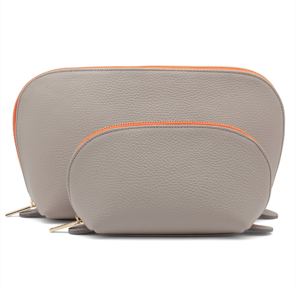 Cuyana Leather Travel Case Set - Unzip the large case to stow all your travel-sized toiletries. Save the small case for make-up, jewelry or any other small necessities. To buy: Cuyana.com, $110