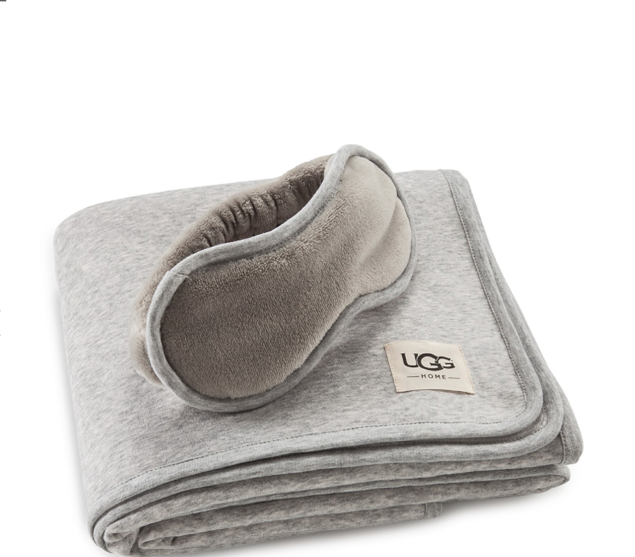UGG Travel Set - Ensure a relaxing and restful trip with a plush eye mask and matching travel blanket that's generously sized to provide cozy comfort no matter how much leg room you've got. To buy: Bloomingdales, $88