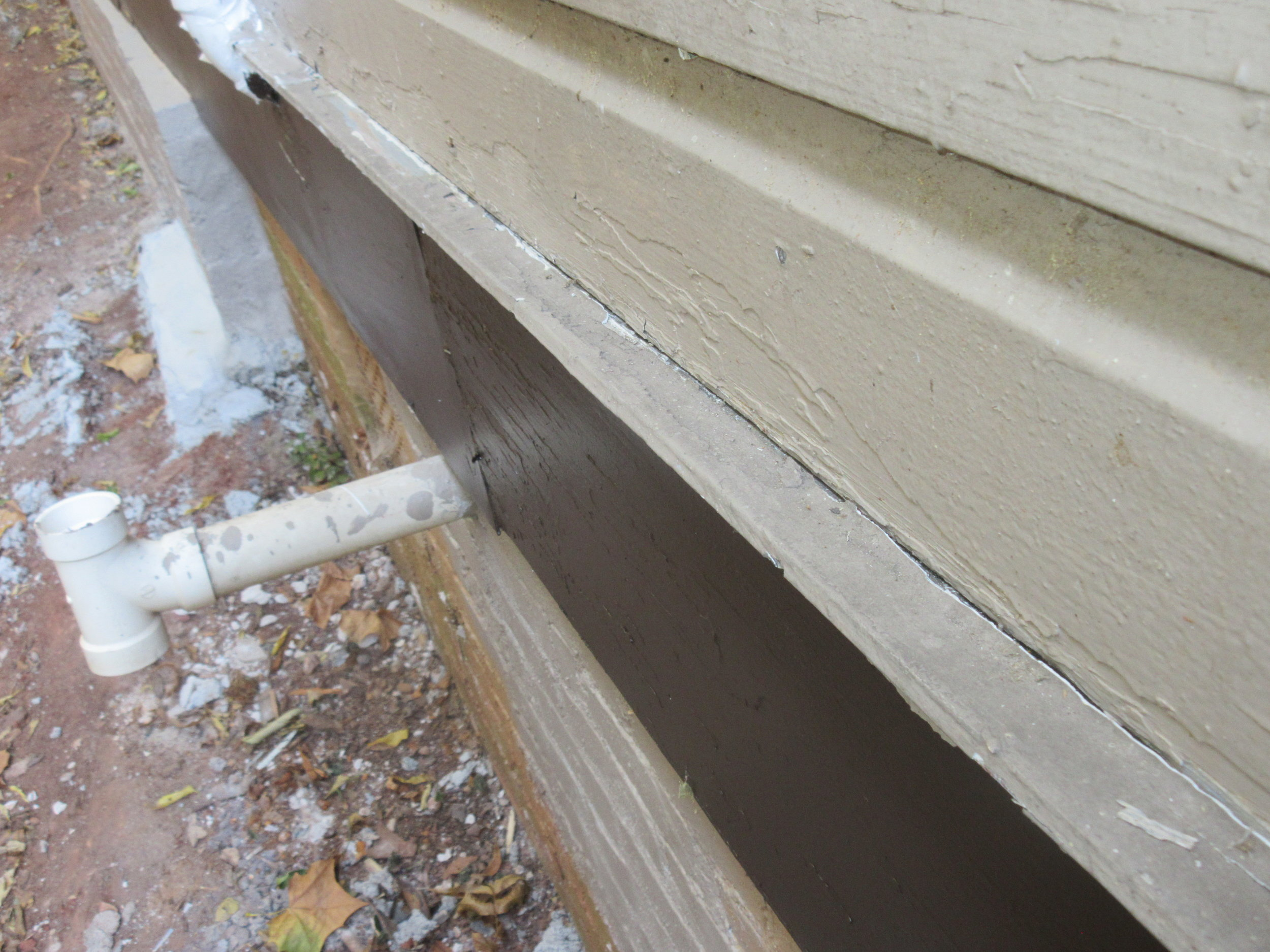 Drip edge for left side trim is angled back towards house where caulk is missing. Recommend drip edge be adjusted, properly affixed and caulked as needed.