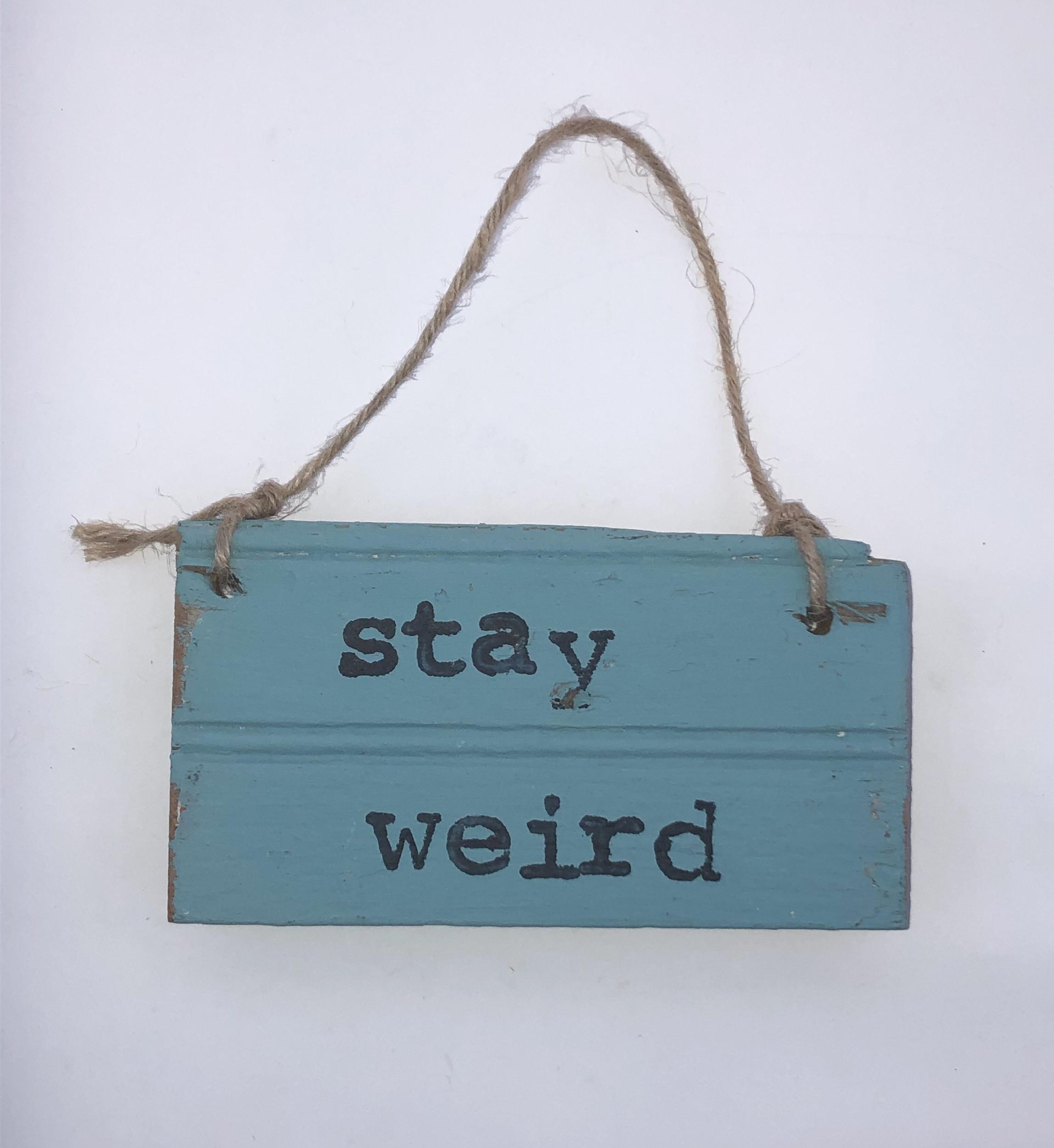 Stay weird.blue sign.jpeg
