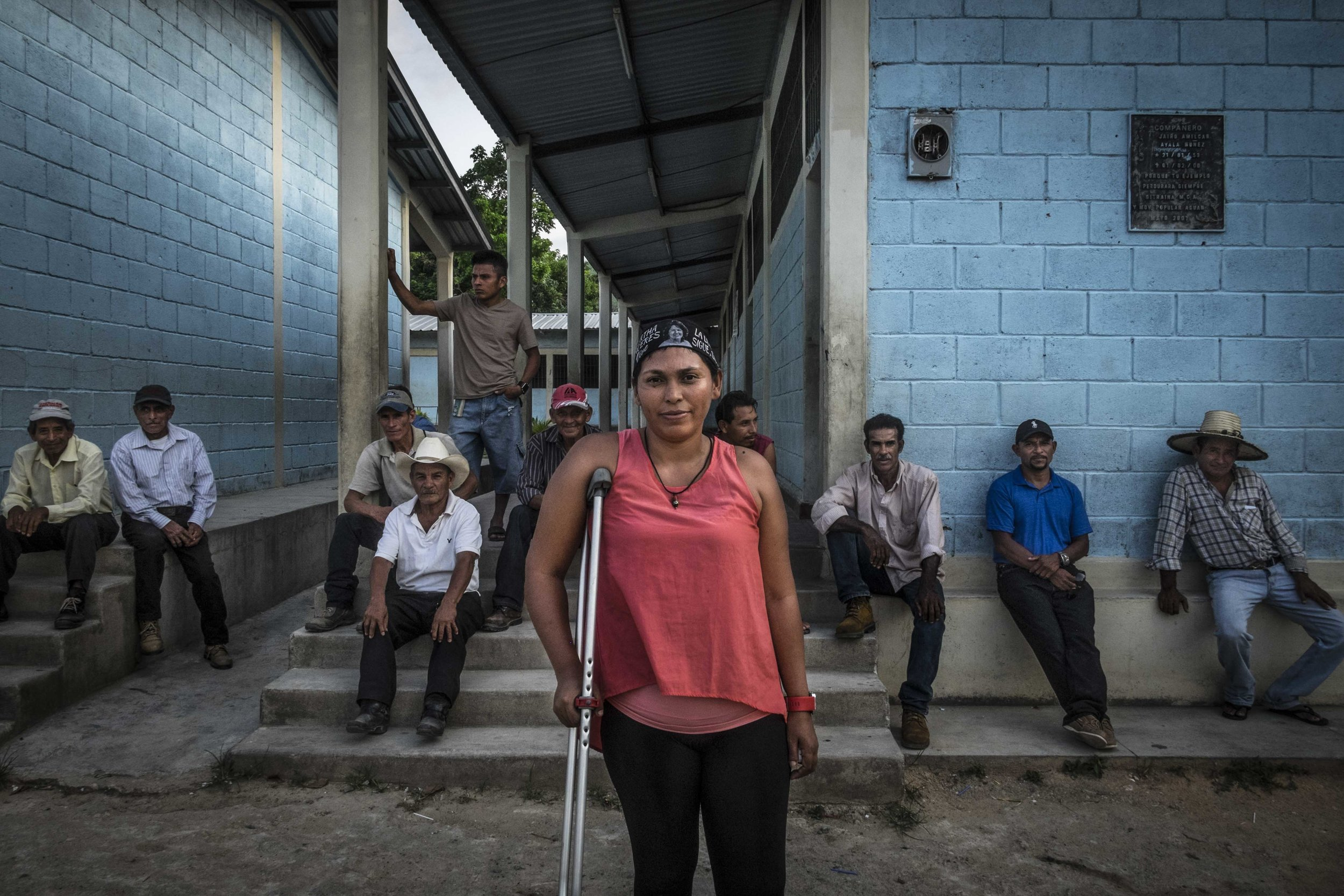 Lemus Irma Amaya, along with members of the small community Guadalupe Carney, outside the city of Tocoa in the department of Colon, Honduras. Irma is the coordinator of (OPDHA) Permanent Observatory of human rights in the Bajo Aguan, representative of the peasants' movement, she was wounded during an assassination attempt against her November 19, 2015 while traveling by motorcycle with his partner who was also a defender of peasants rights , he had suffered an assasination attack a week before Irma.