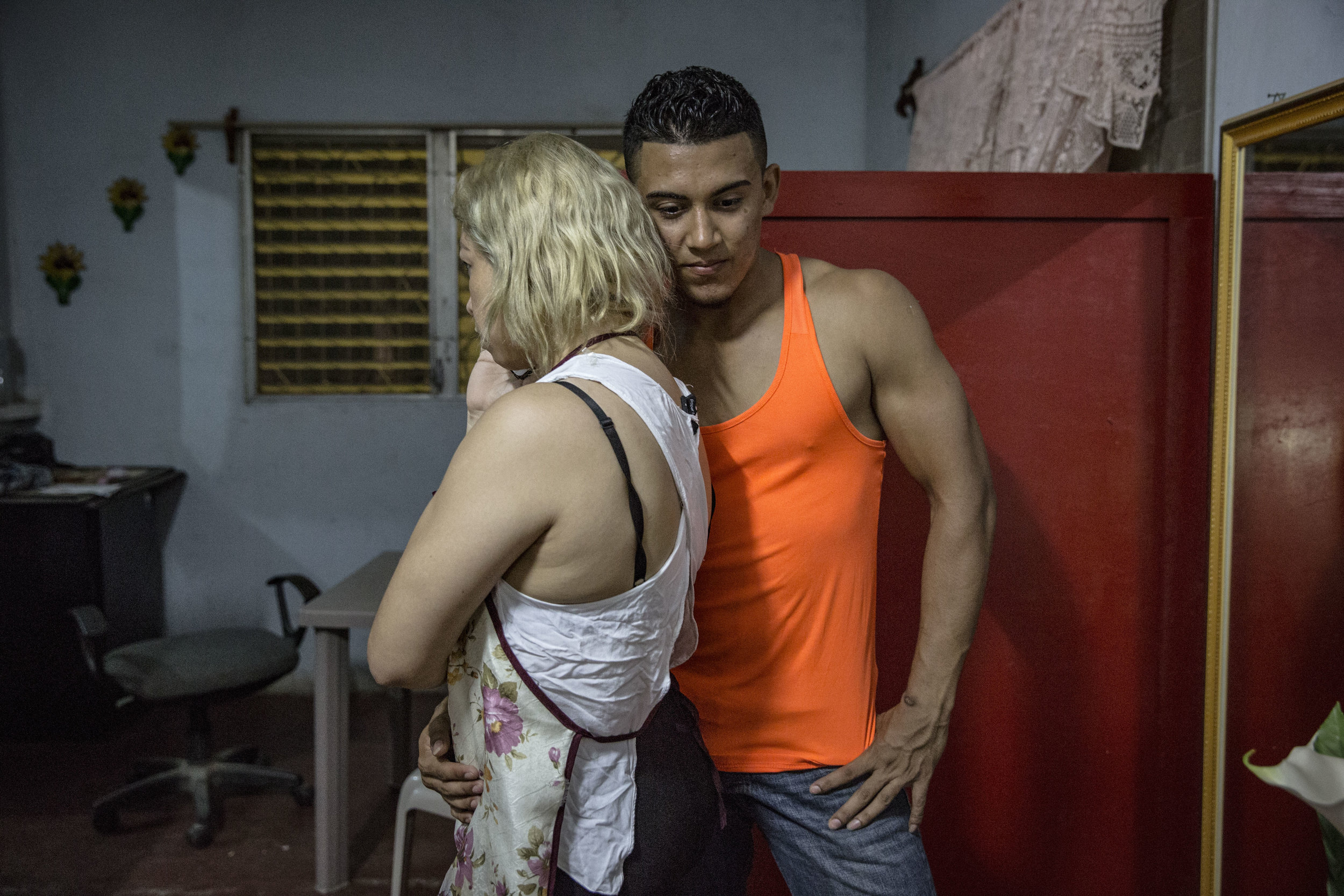 Friends of Darwin: Ruby, a transgender from Lima, near San Pedro Sula, and his boyfriend, before a night out.