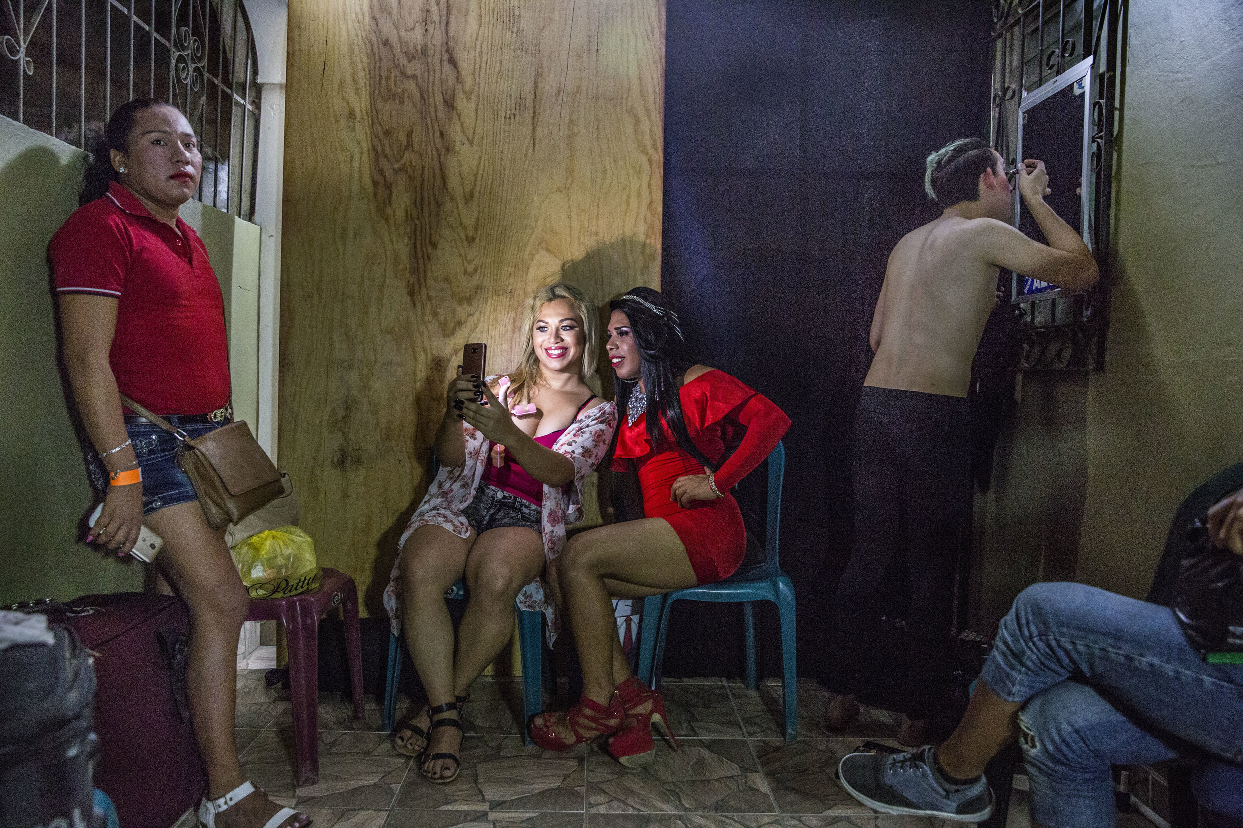 Briana (right) with her friend Ruby, a transgender from San Pedro Sula, take a selfie in the backstage of a beauty contest event. Ruby won the competition that night.