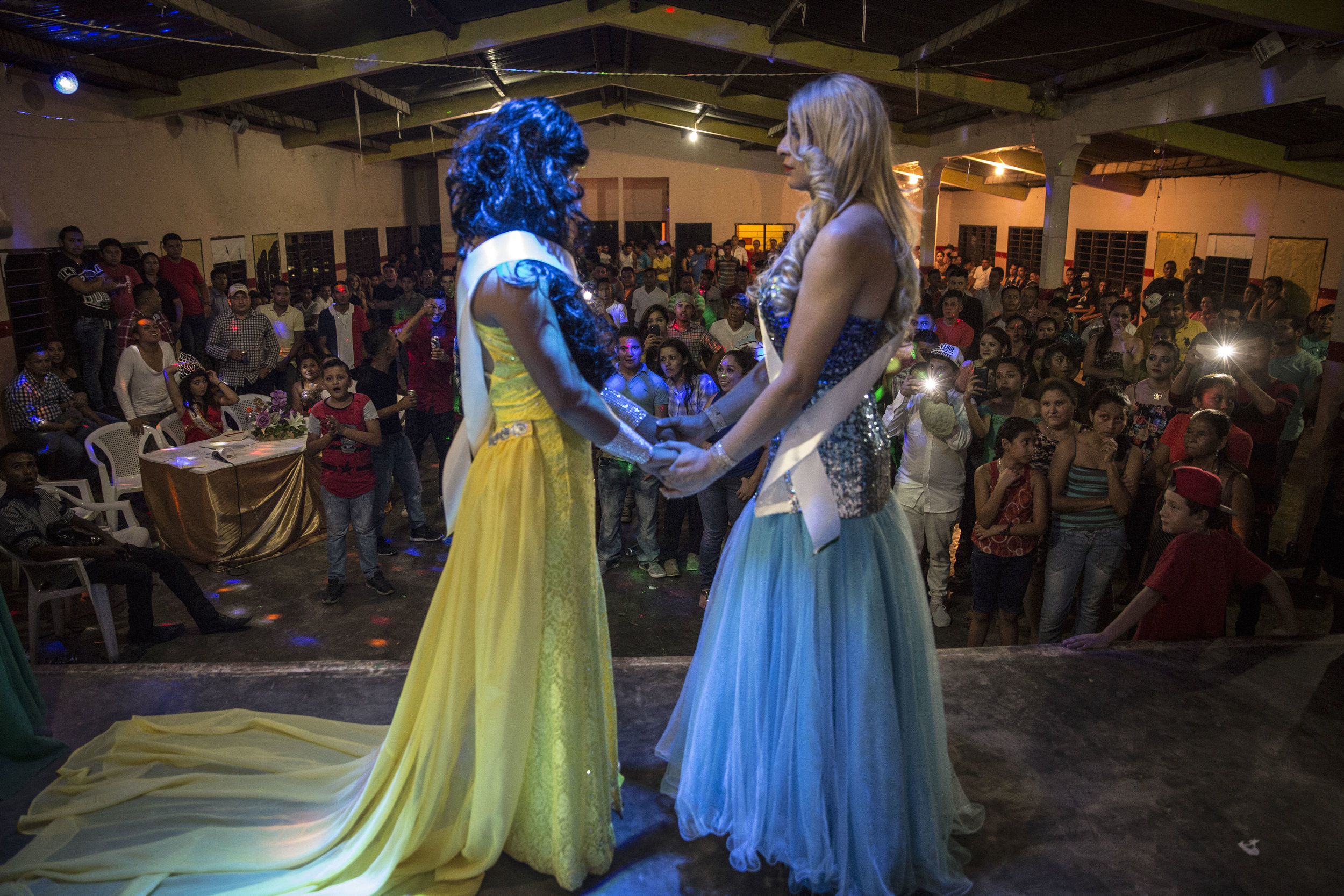 Two contestants at a beauty contest in San Antonio de Cortes, moments before hearing the final call of the judges on who's going to be the winner.