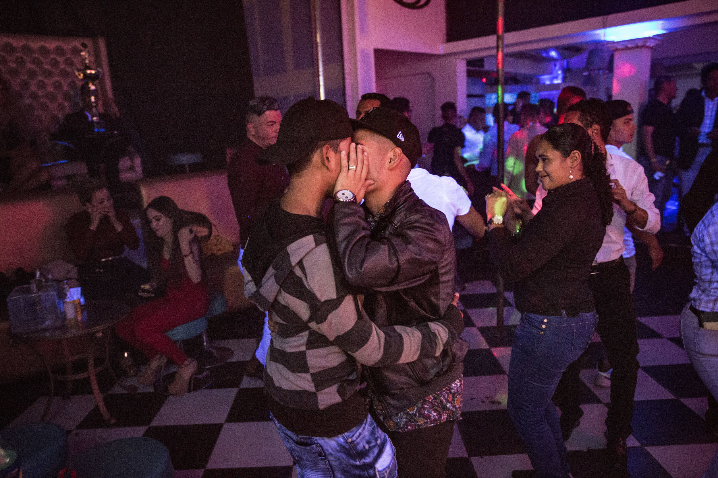 A couple kissing in a gay friendly club in Tegucigalpa.