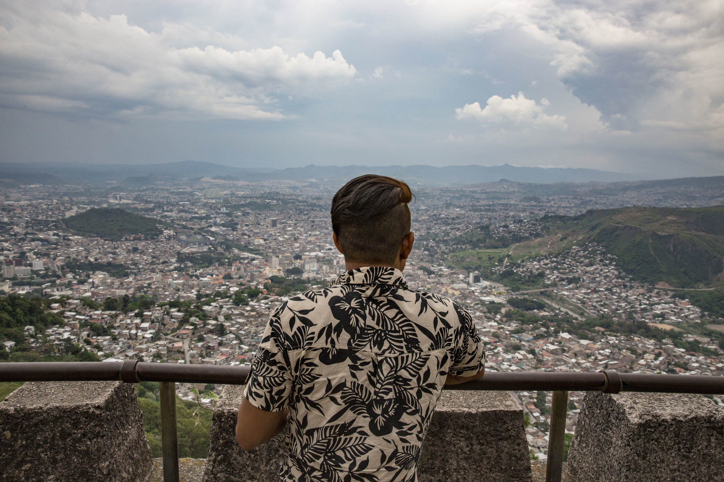 Darwin overlooking Tegucigalpa, where he lives. Darwin is not safe, he has been threaten by the same gang that murdered his brother.