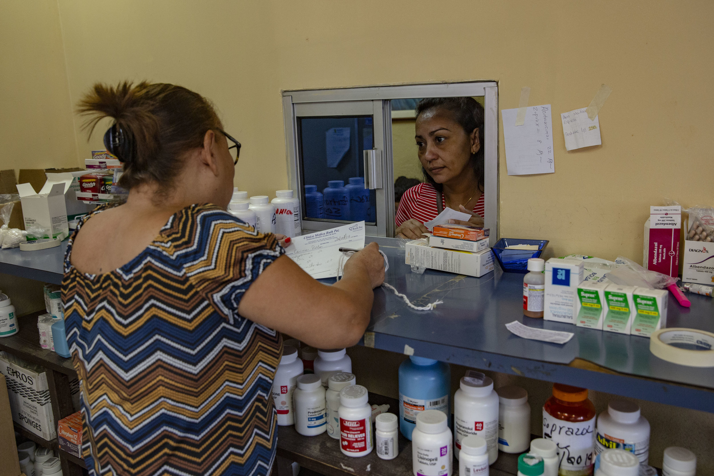 Patients get their free medications at the Ruth Paz clinic in Bogràn, a pretty dangerous neighborohood in San Pedro Sula, Honduras.