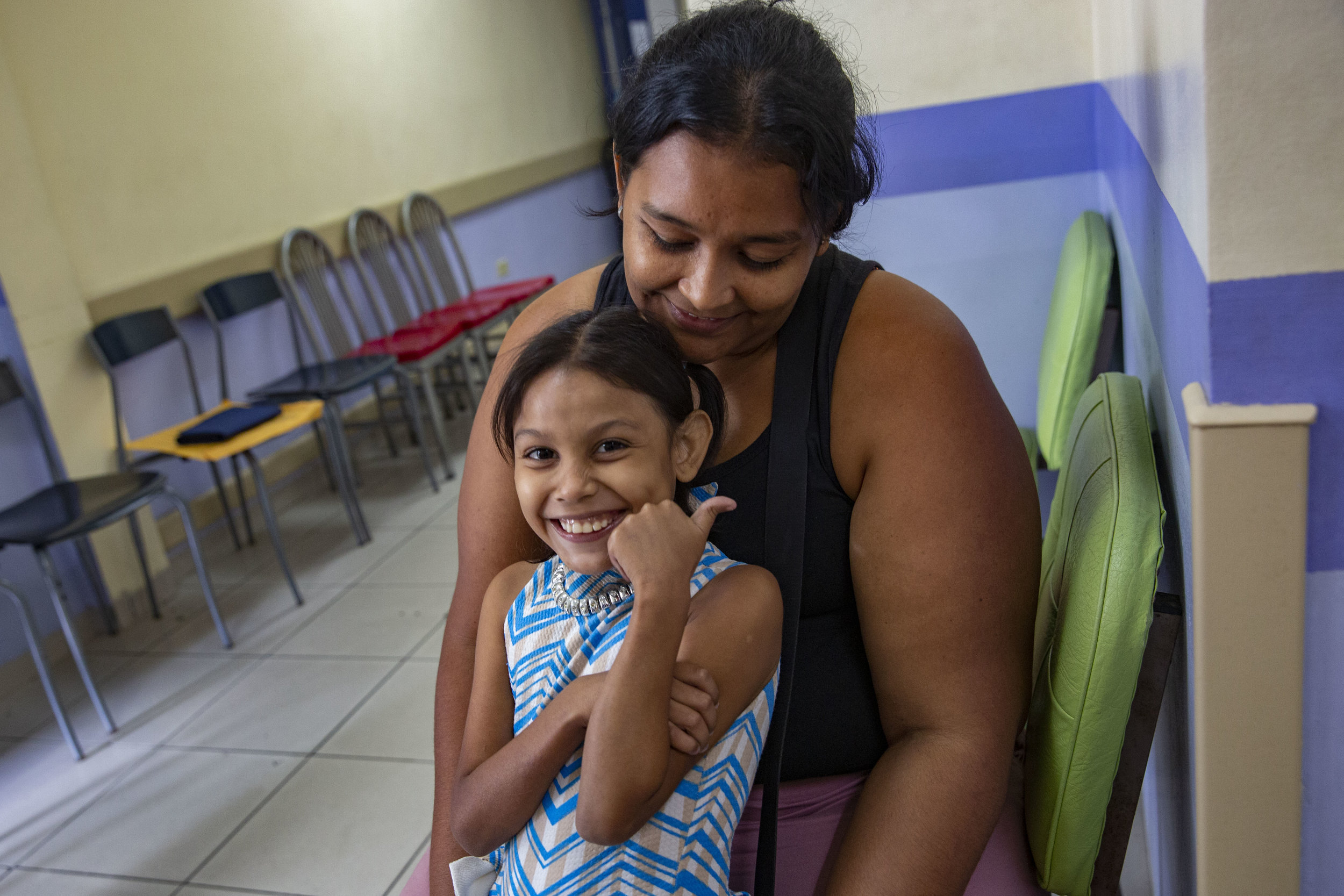 A mother and child waiting to be visited by Dr. Craniotti, head and pedriatic surgeon at the Ruth Paz hospital in San Pedro Sula, Honduras.
