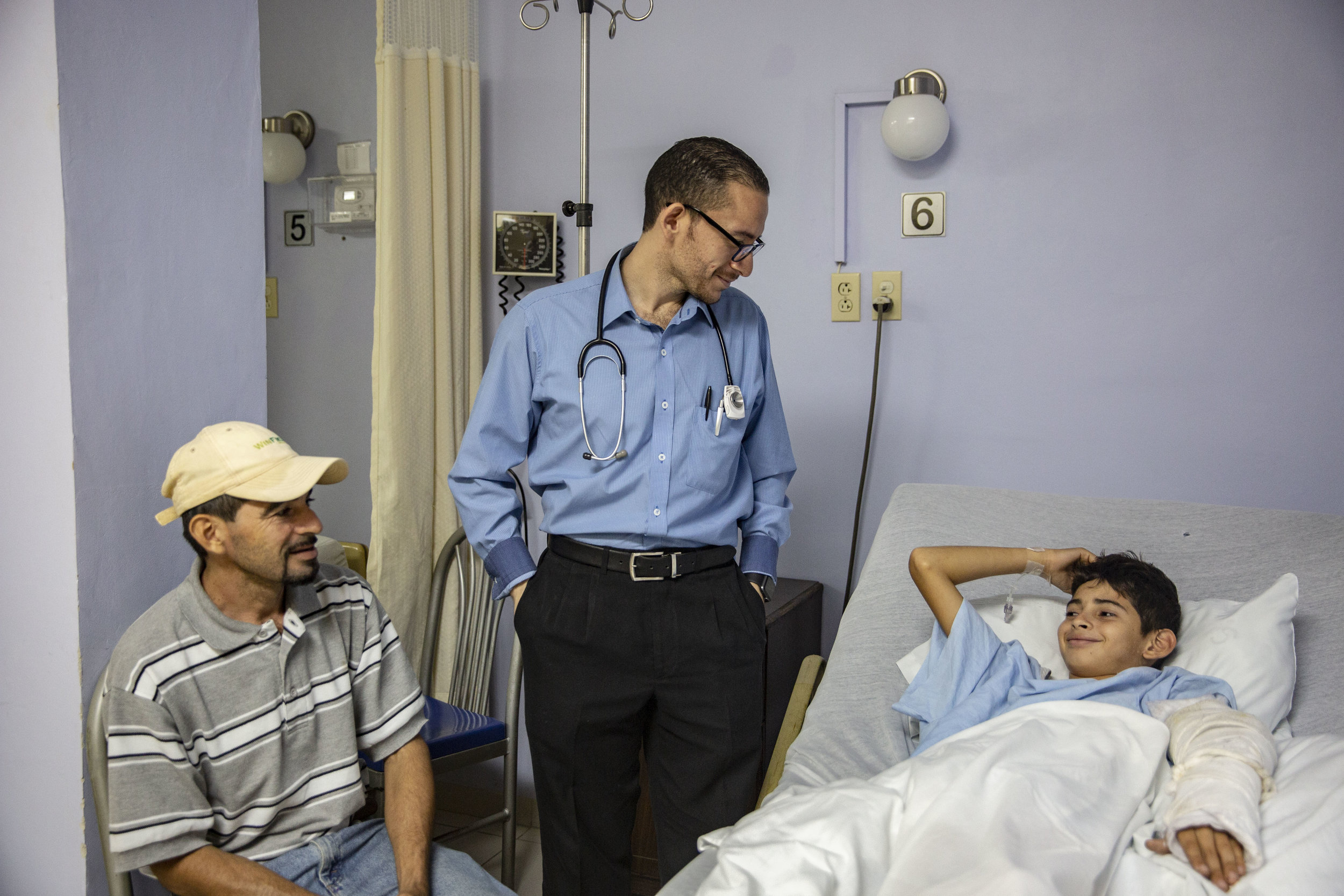 Dr.Hernandez, pedriatician, visits a boy who came out out surgery for a broken arm, at the Ruth Paz hospital in San Pedro Sula, Honduras.