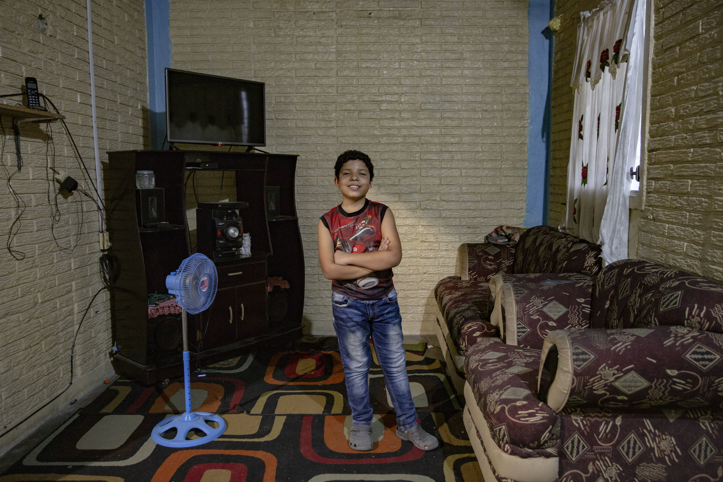 Jose Danilo Ramos is 10 and was born with anorectal malformation. Here in the living of his house where he lives with his family in San Pedro Sula, Honduras.