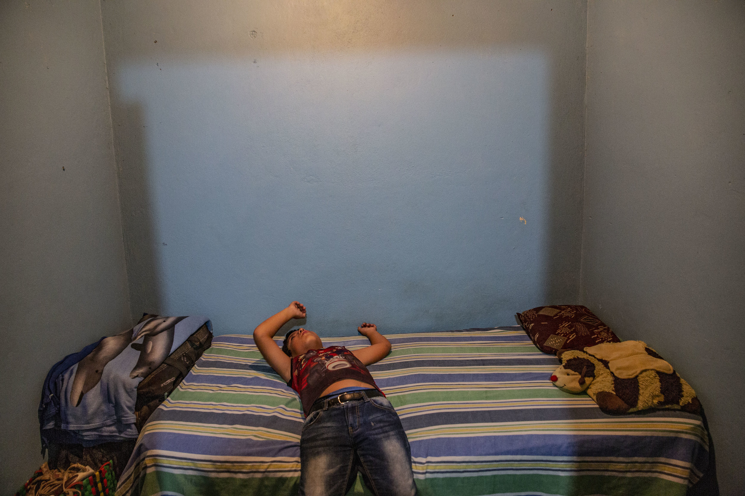 Jose Danilo Ramos is 10 and was born with anorectal malformation. He had multiple operations at the Ruth Paz hospital, here in his bed in his home where he lives with his family in San Pedro Sula, Honduras.