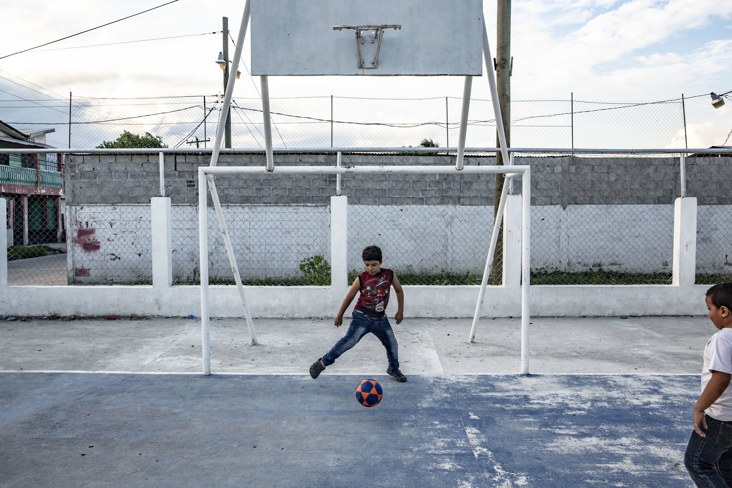 Jose Danilo Ramos laying football next to his house. He is 10 and was born with anorectal malformation. He had multiple operations at the Ruth Paz hospital, in San Pedro Sula, Honduras.