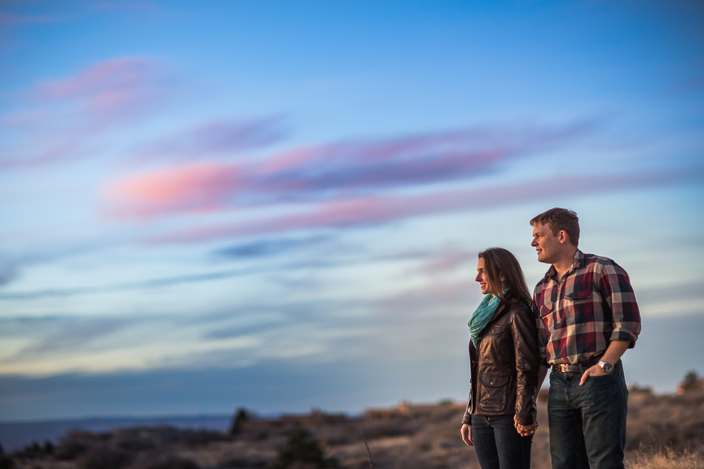 The sky is blue, pink, purple, and beautiful for this engagement photo