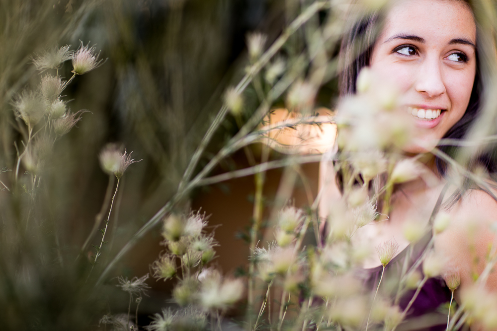 Beautiful plants frame Rachael's face in this senior portrait shot
