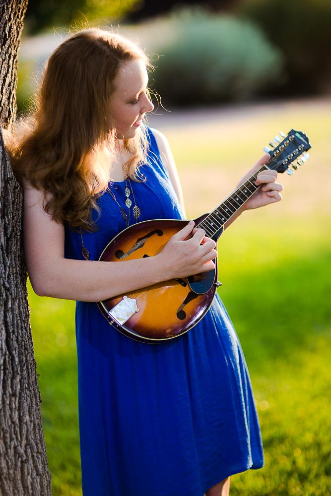 Sarah playing her mandolin in this senior shoot