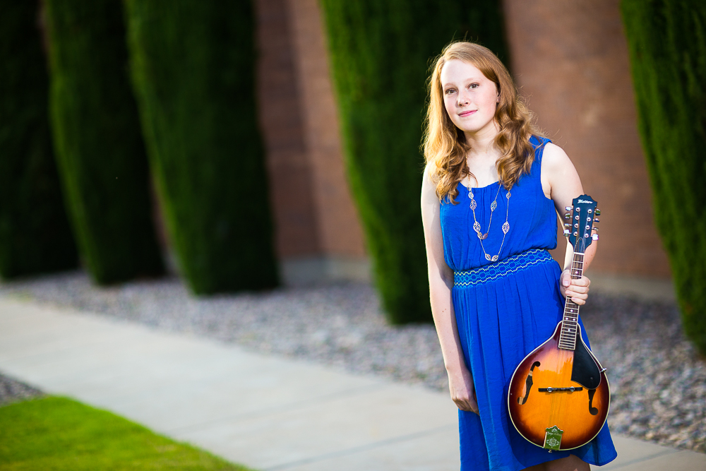 Senior session photo with music instrument