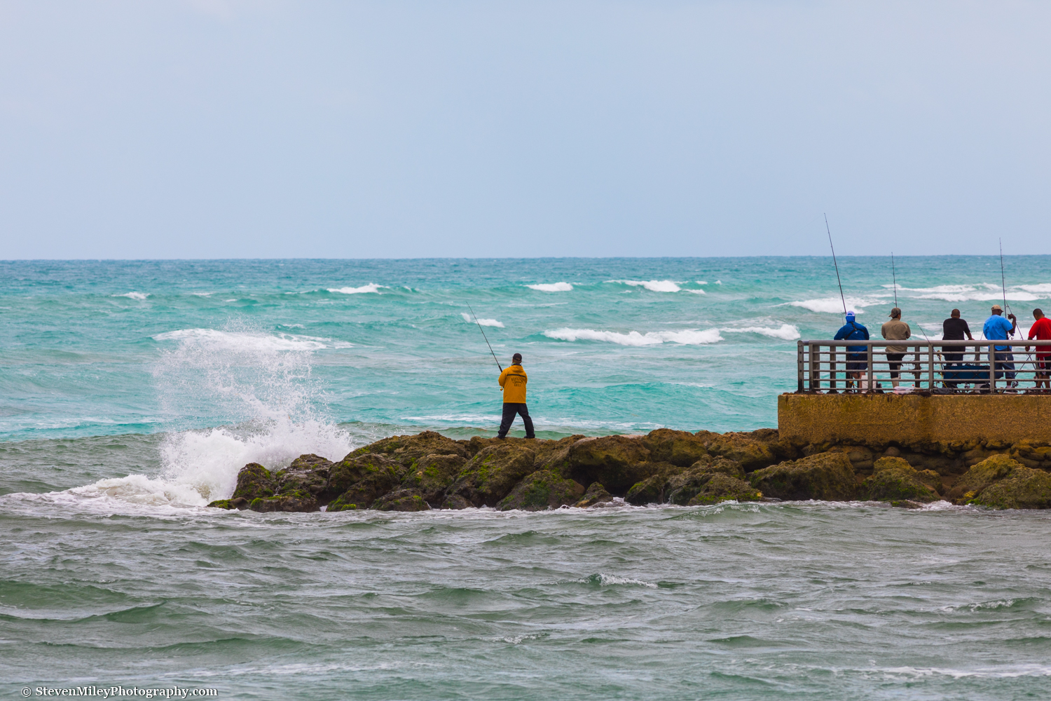 Fishers on the south jetty of Sebastian Inlet State Park, Florida.