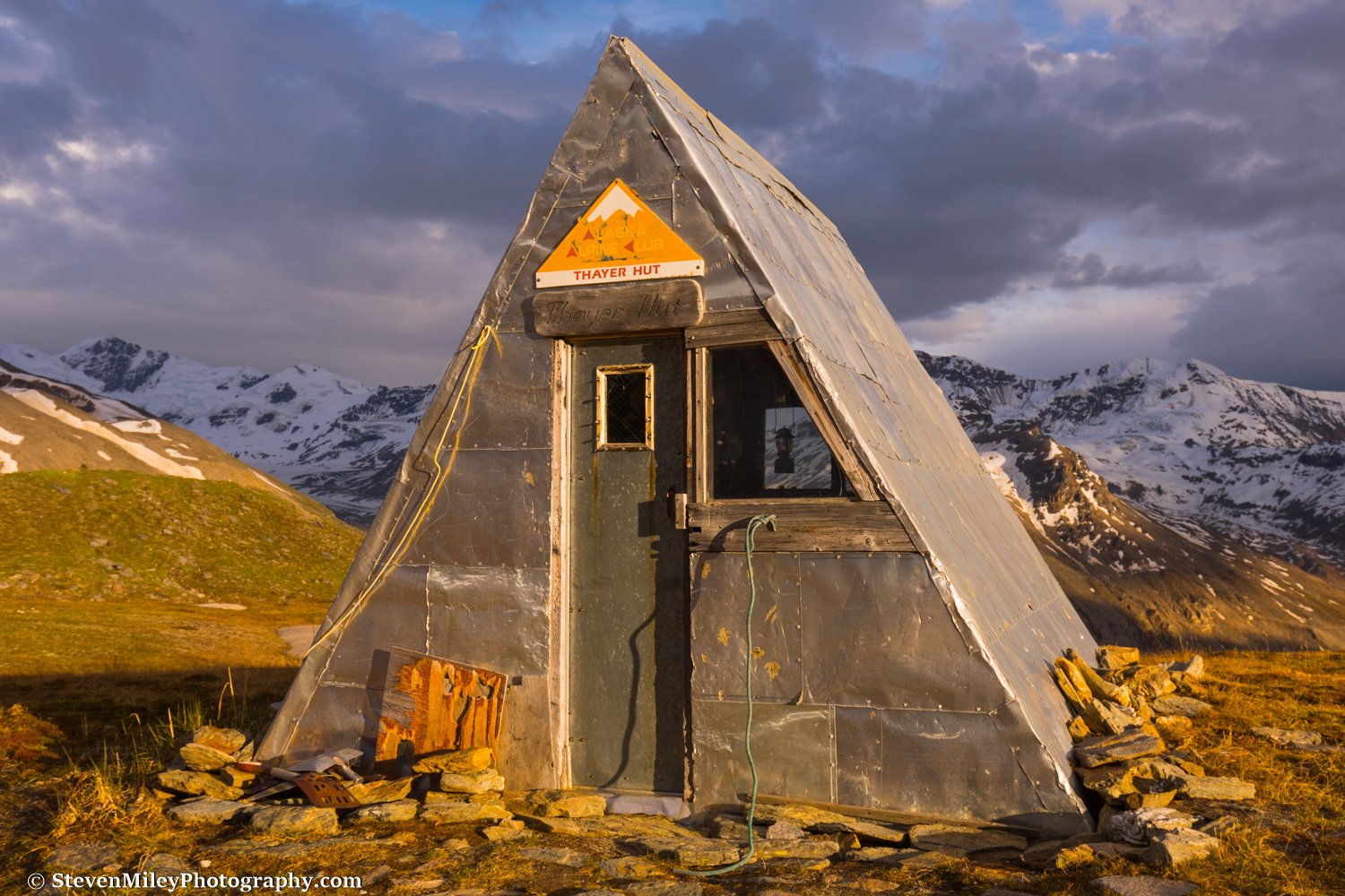 The Thayer Hut in the evening sun with the familiar lantern hanging in the window.