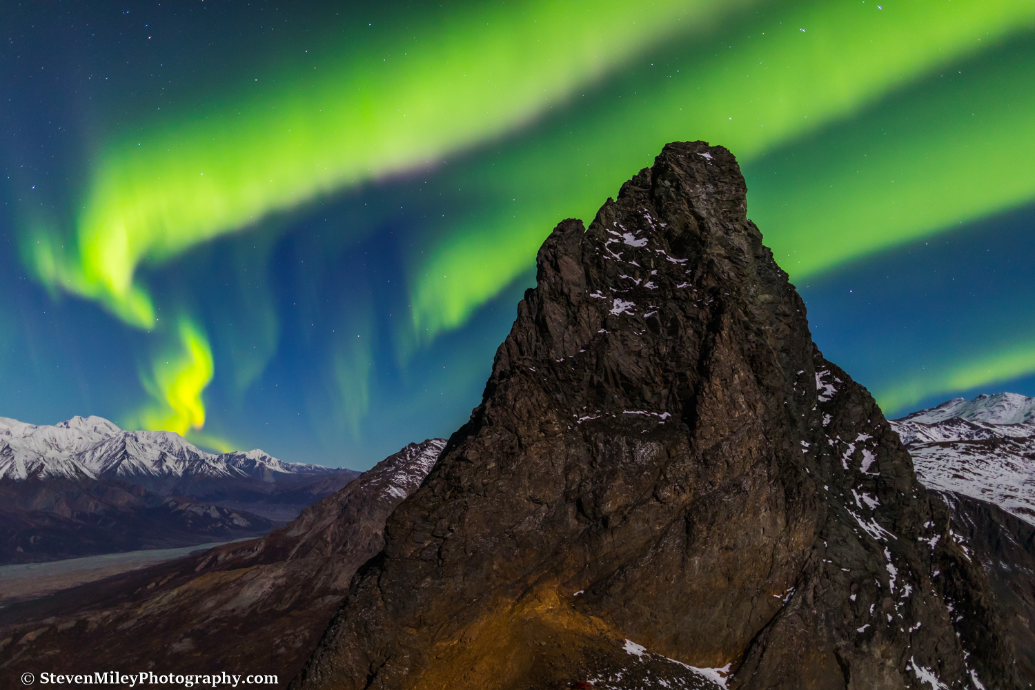 Aurora borealis over Devils Thumb in the Alaska Range, near Black Rapids.