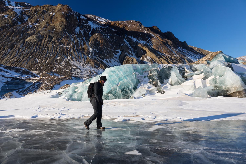 Hiking Over Frozen Lake Beside Black Rapids Glacier