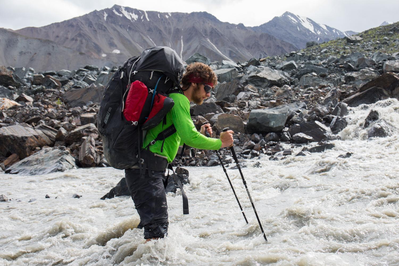 Crossing A Stream On McGinnis Glacier