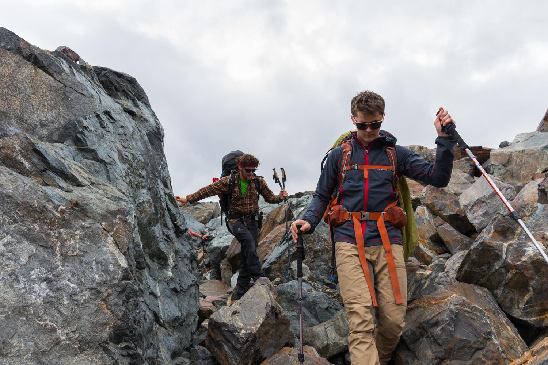 Hiking Over Boulders On McGinnis Glacier