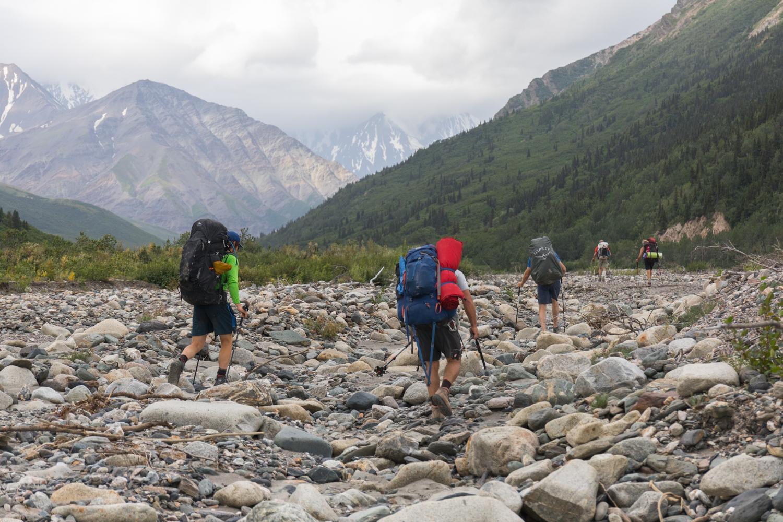 Backpackers Hiking Into The Alaska Range