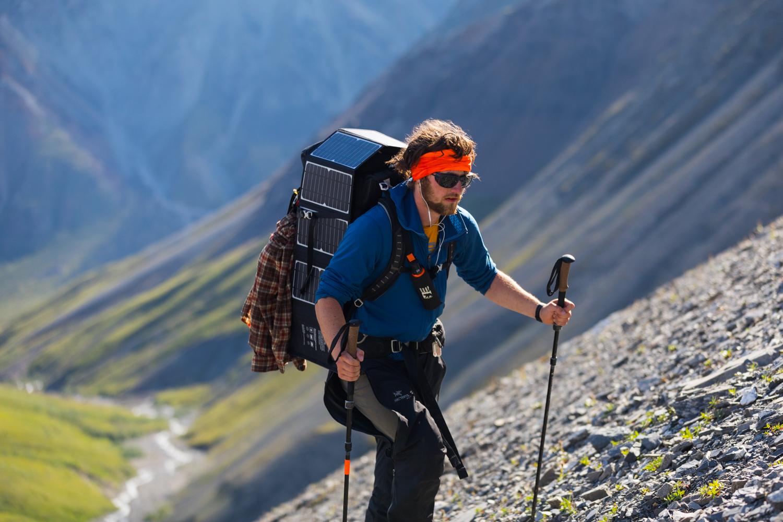 Backpacker Ascending Scree Slope - Alaska Range