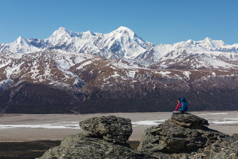 Backpacker Taking In View Of The Alaska Range