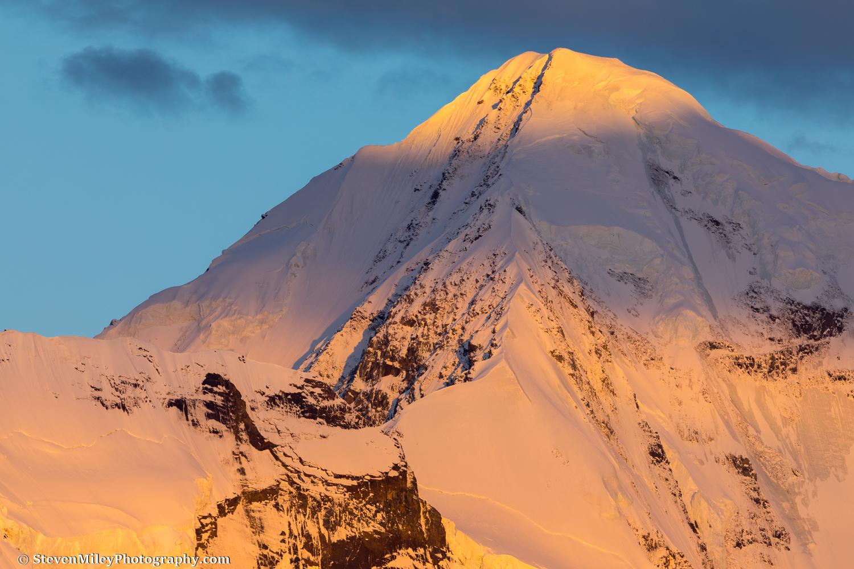 McGinnis Peak's summit glows at sunrise.
