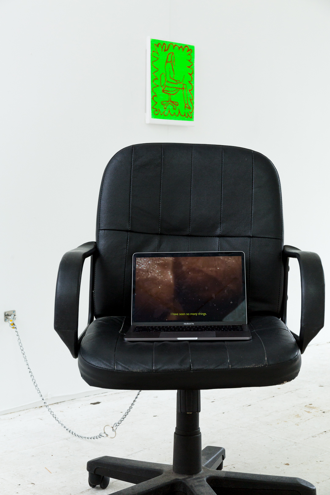 I am cute and organised  (foreground), (2018), digital video, laptop, chair, chain;  Seated Figure  (background) ,  (2018), acrylic on linen, installation view,  Number One Assistant,  Kyra's, Sydney. Photo: Document Photography
