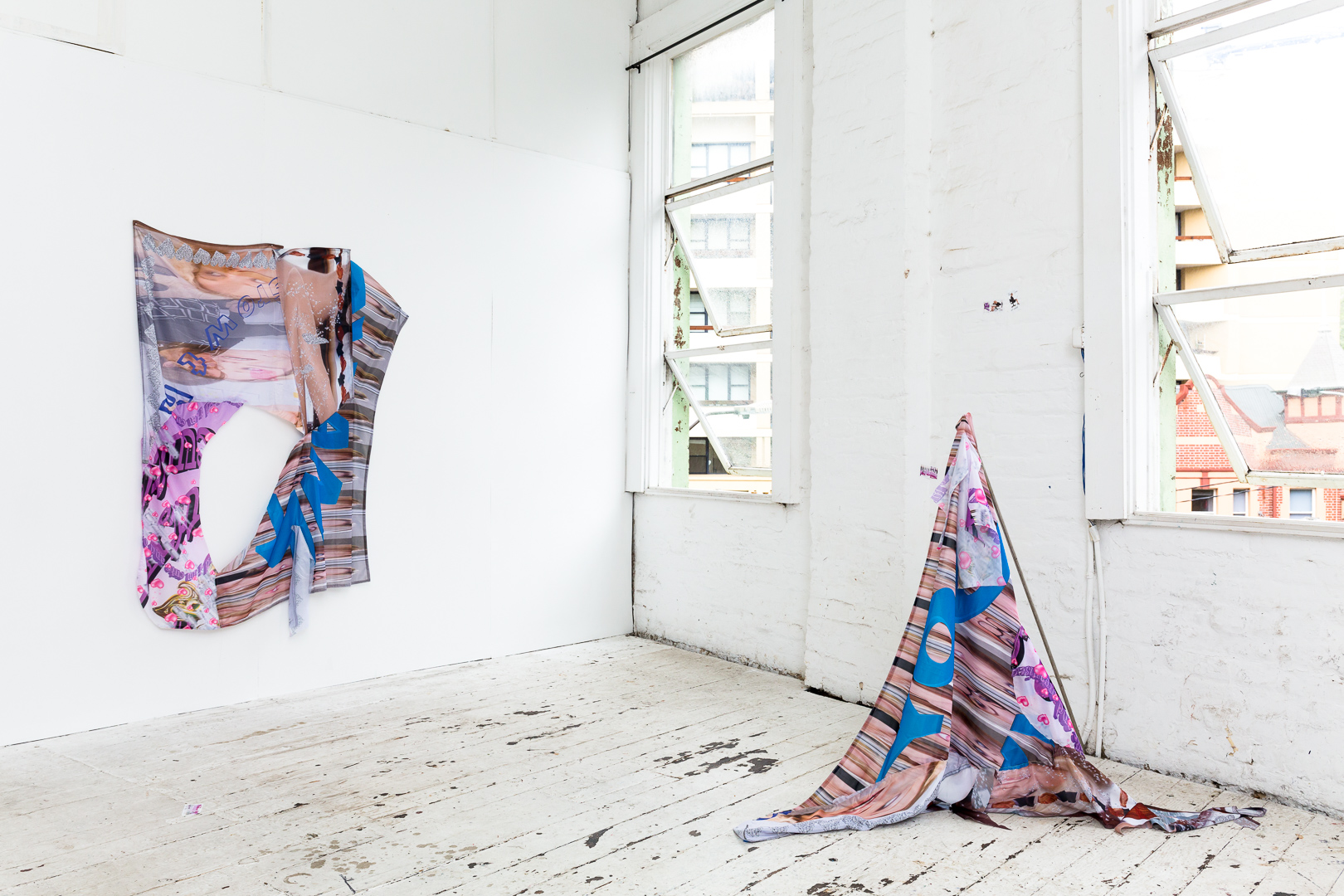 Dreams of an Assistant II  (background), (2018), digital print on polyester ; Dreams of an Assistant III  (foreground), (2018), digital print on polyester, stainless steel rods, installation view,  Number One Assistant,  Kyra's, Sydney. Photo: Document Photography