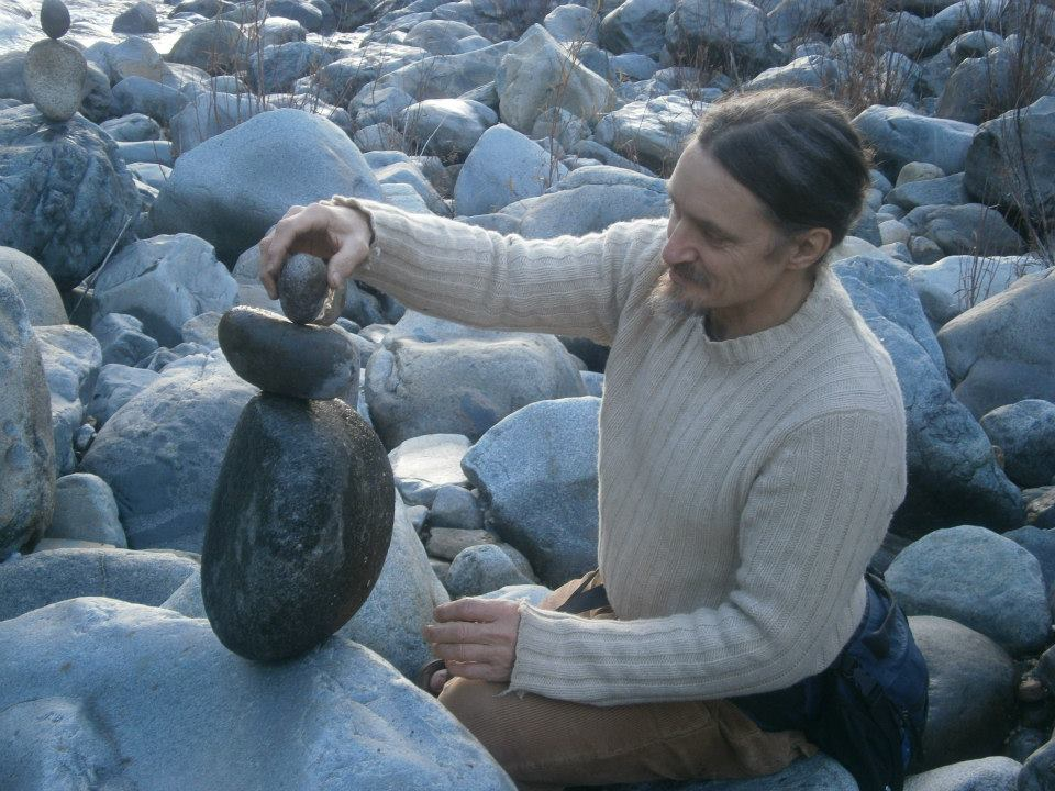 Amaru Hafiz stacking Rocks