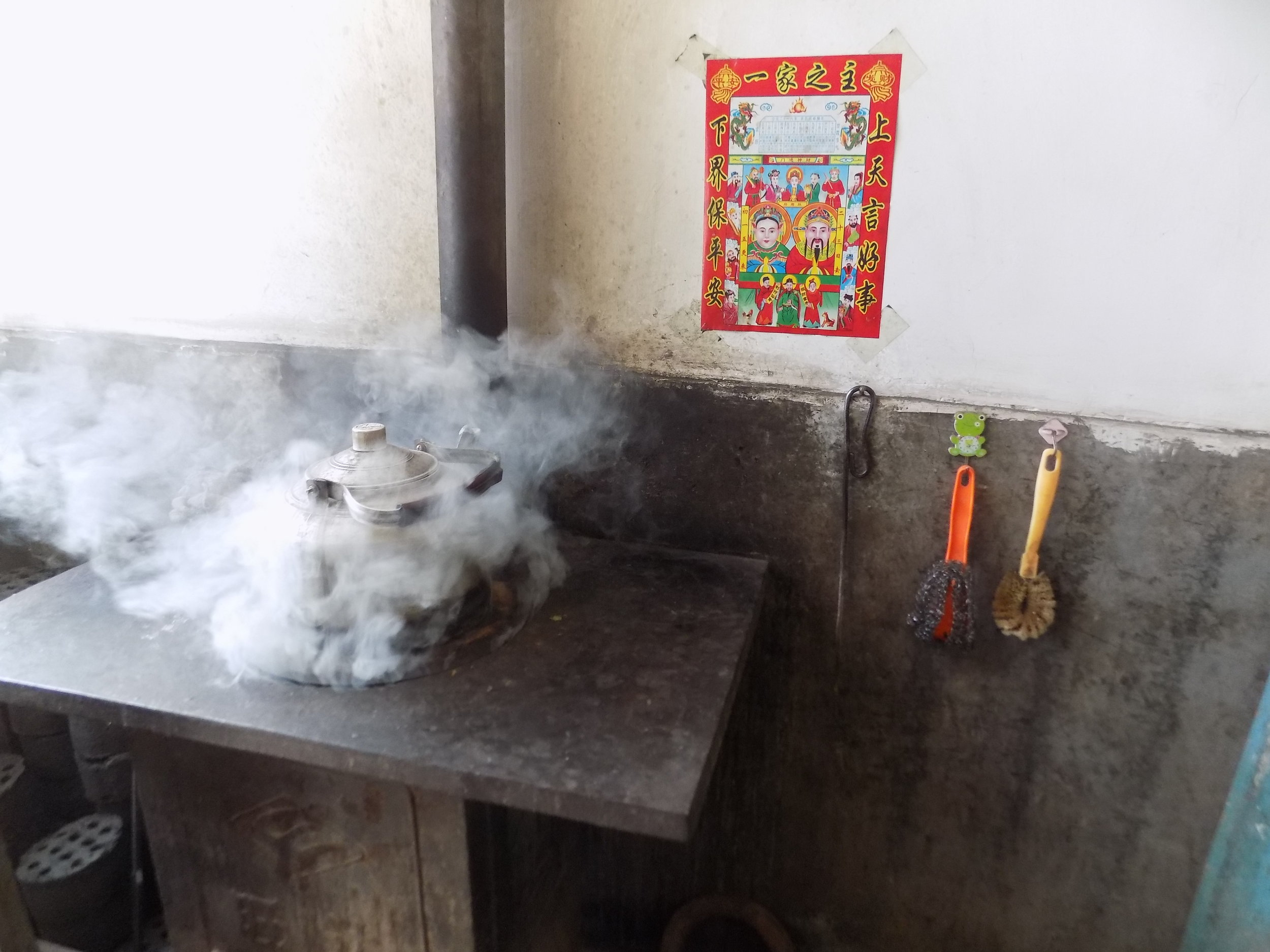 Photo 1: Water is heated on a traditional chimney stove in Shanxi Province, China. Coal is used as fuel which, when burnt, can release a large amount of toxic air pollution into the home through inefficient combustion.