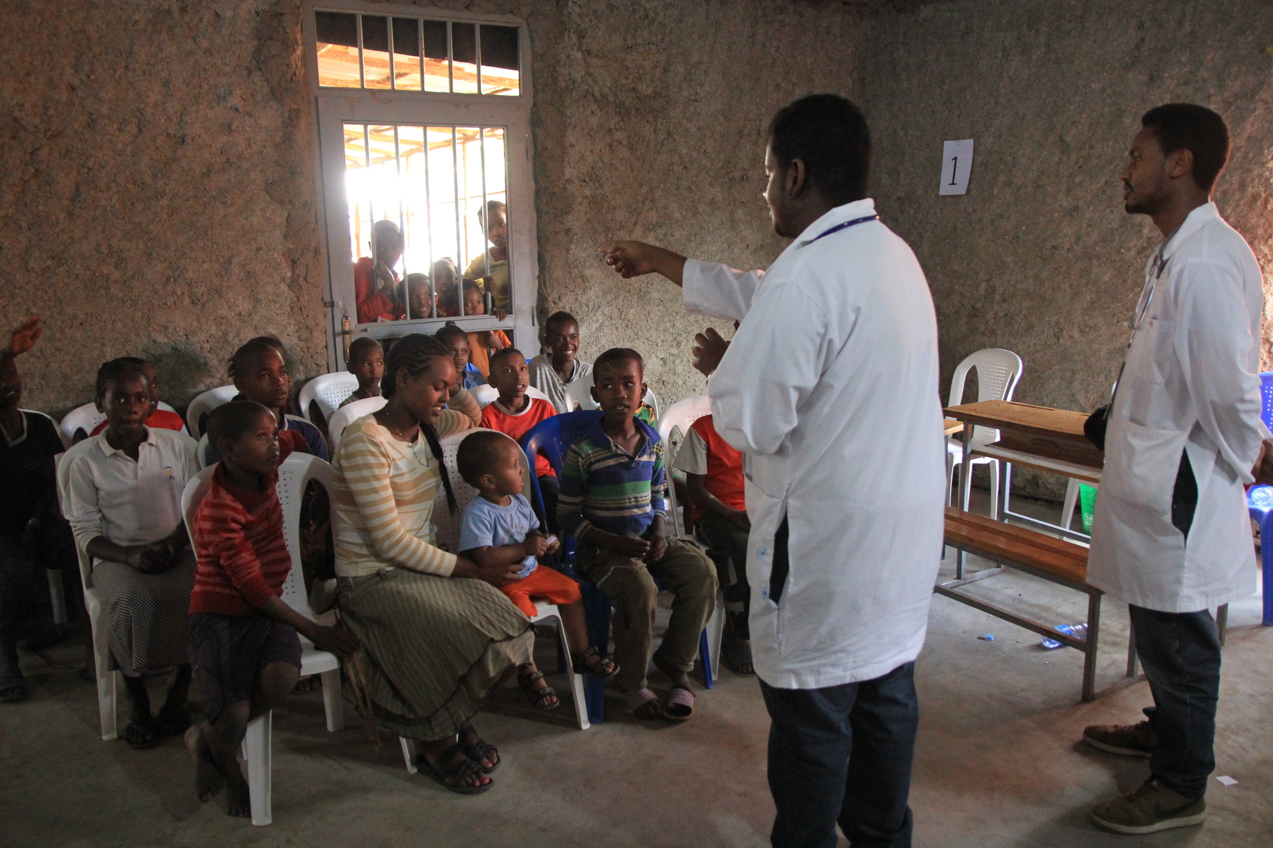 Picture 5: Mobile clinic in Hawassa: Day 3 Ethiopian medical students teaching the children about hand washing and dental hygiene. More than 125 children participated in the teachings and activities.