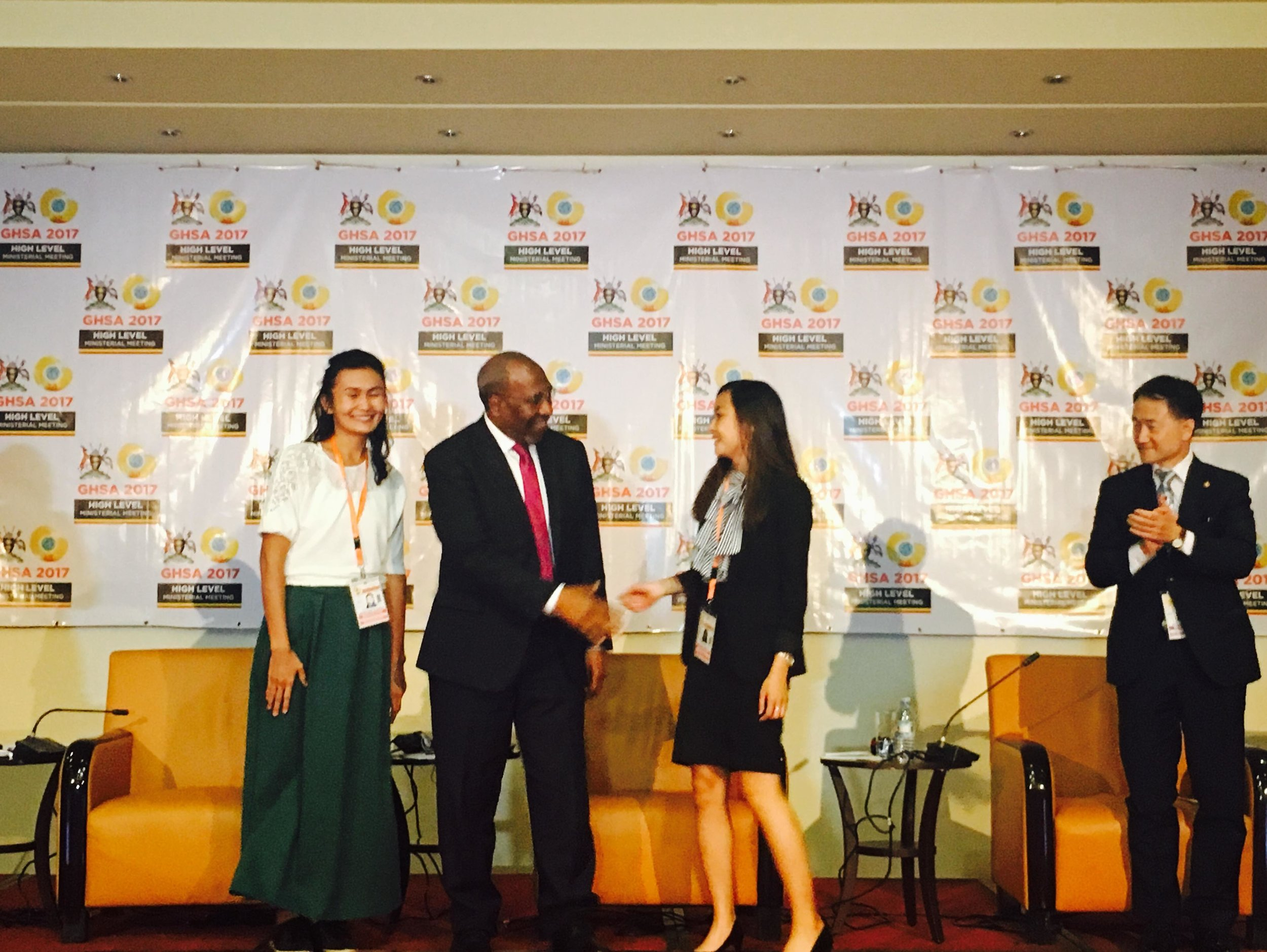 From left to right: Lyazzat Musralina (Scientific Researcher at Institute of General Genetics and Cytology of Kazakhstan), Hon. Ruhakana Rugunda (Prime Minister, Uganda), Ashley Tseng (McGill University), and Hon. Park Neunghoo (Minister of Health & Welfare, Republic of Korea). Ashley is shown here shaking the Prime Minister of Uganda's hand after his announcement of her and Lyazzat as the winners of Nuclear Threat Initiative's Next Generation for Biosecurity in GHSA Competition.