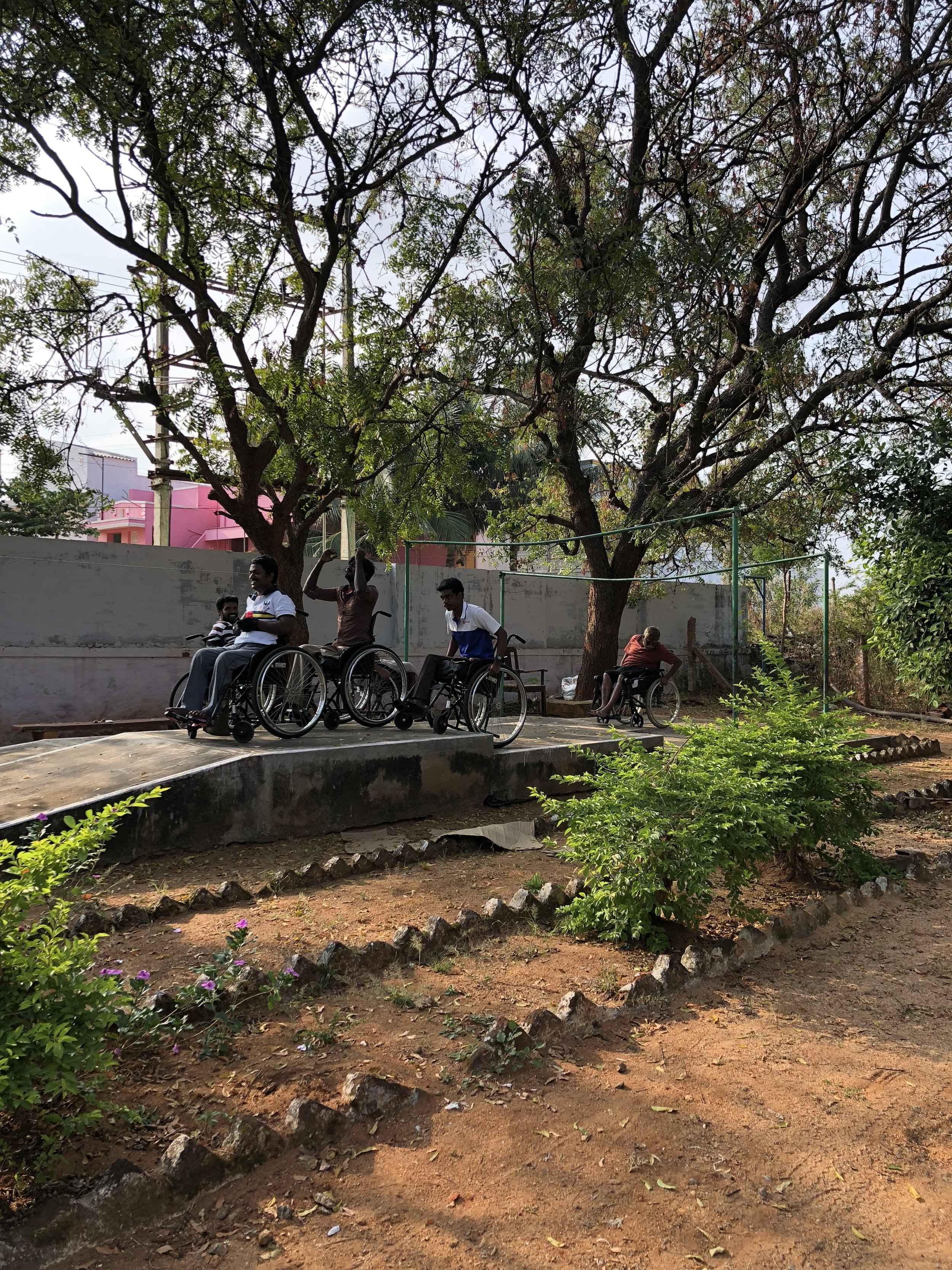 Wheelchair training at the outdoor course (equipped with ramps, stairs, gravel, dirt paths, road bumps)