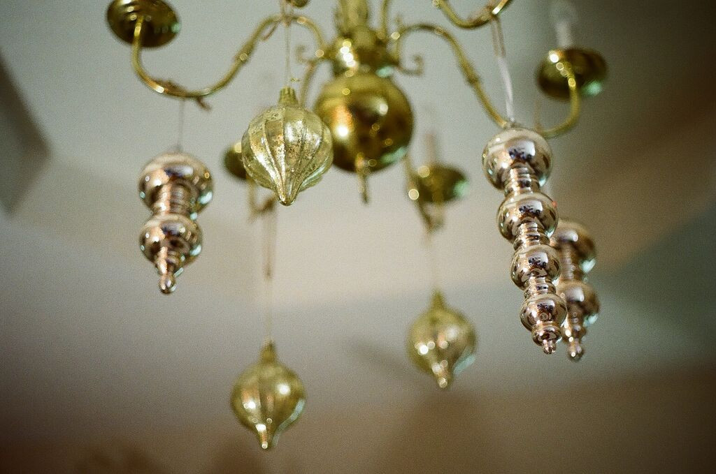 """To Christmas"", verb:  to make everything, down to the light fixtures, as festive as possible."