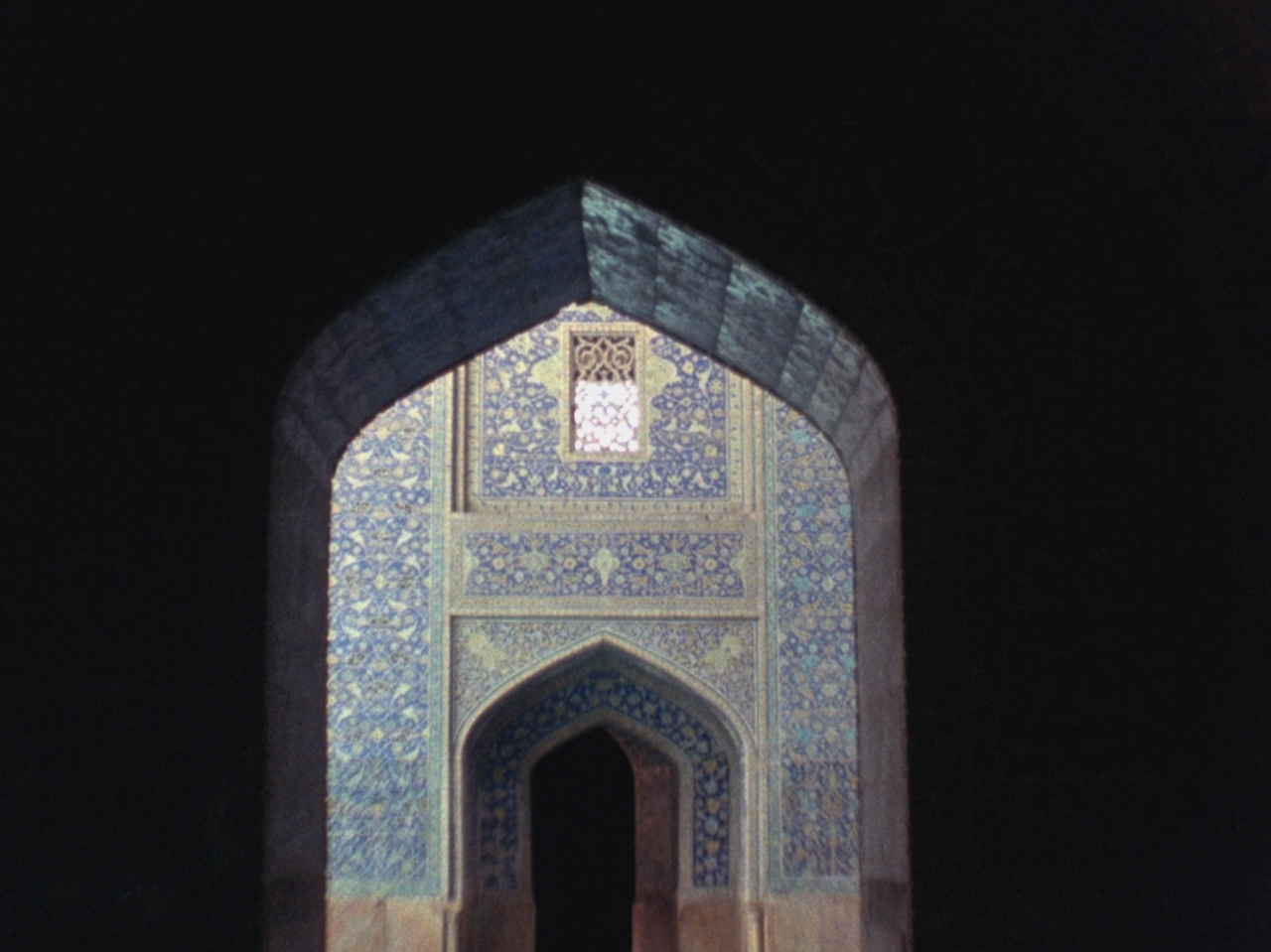 Remembering the Pentagons     Azadeh Navai   2015  /  23 minutes  /  Iran/USA  /  16mm / sound  A slow, rhythmic and contemplative journey into filmmaker Azadeh Navai's earliest childhood memories. With an old 16mm Bolex and a hand-made pinhole camera, Navai returns to Tehran and Esfahan, Iran, where the perceptions and recollections of places, emotions, and scents serve as vehicles through which she exposes a deeply personal landscape. She asks - what is the texture of memory? In what ways does time - the light, wind, and air of history - wear upon the monuments and the images of the past? Her camera, gliding through mosques and the heady wares of a bazaar, provides grounding to narrative themes of childhood wonder and familial tragedy. But, as in memory, there is trouble in the image. The convulsions of recollection are perceptible even in the shifting grains of the film image - kaleidoscopic in their geometries of instability and flux.  Born in Tehran during the Iran-Iraq war, Navai seeks to access a time of personal turmoil both for her family and for her birth country in this poetic capturing of place, history and memory.