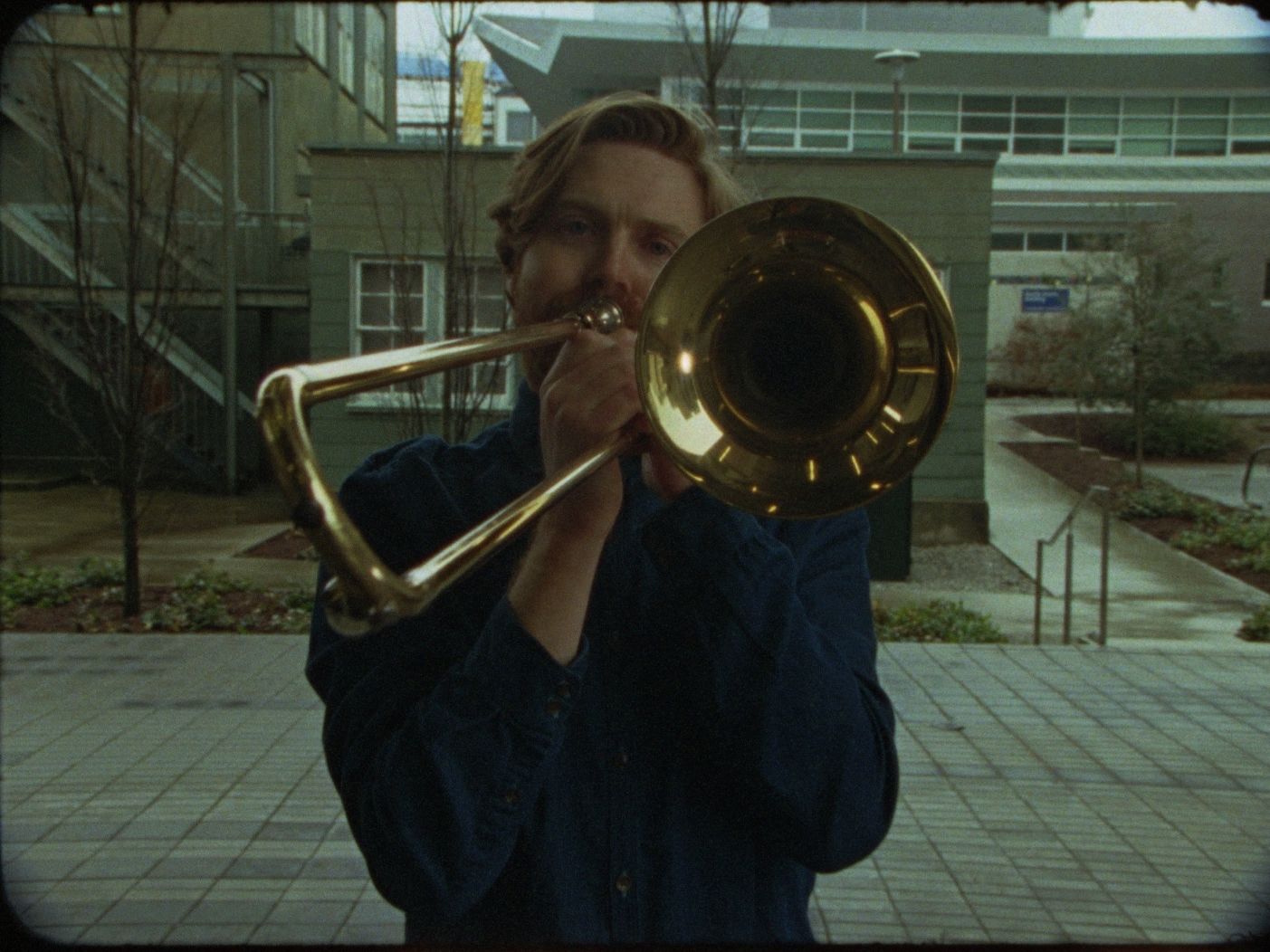 Etude      B     rian Lye   2017 |3 minutes | Canada |16mm | color |sound | international premiere  A trombonist and a dolly zoom. Questionable suspense and the sound of morning fog. Etude plays with film history, repetition, and a special effect that lacks a narrative home. -BL
