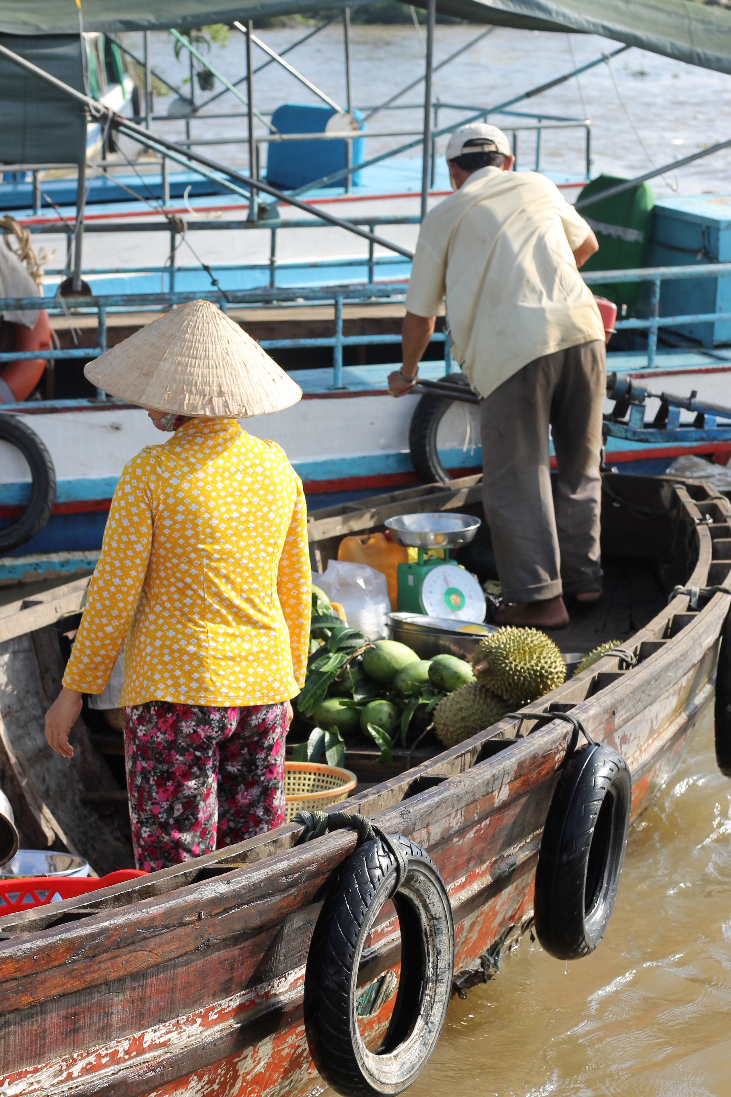 Fruit sellers at a floating market in the Mekong Delta.