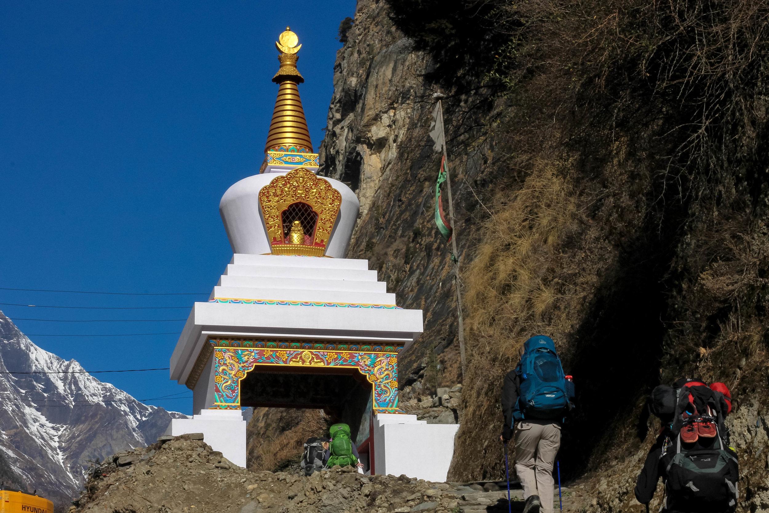Passing through a stupa chorten (Buddhist religious monument).
