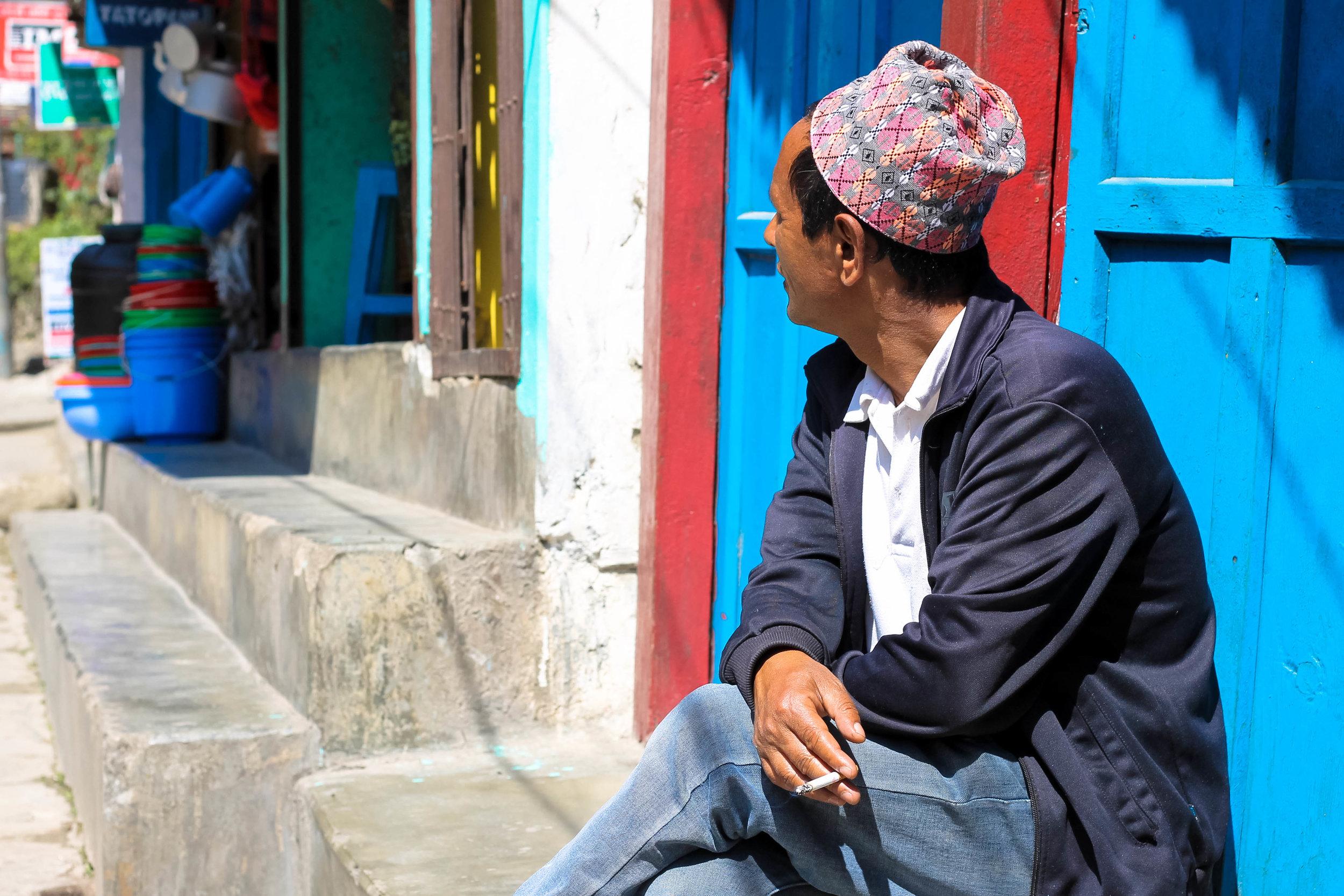 A villager in sunny Tatopani.