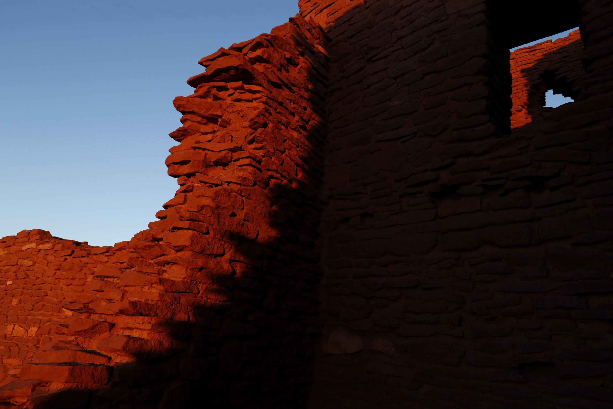 The sun rises on the Wukoki Pueblo, Thursday, Oct. 6, 2016, near Flagstaff, Ariz.The Wukoki were in the area between the years of 1120 through 1210. (Kevin Martin)