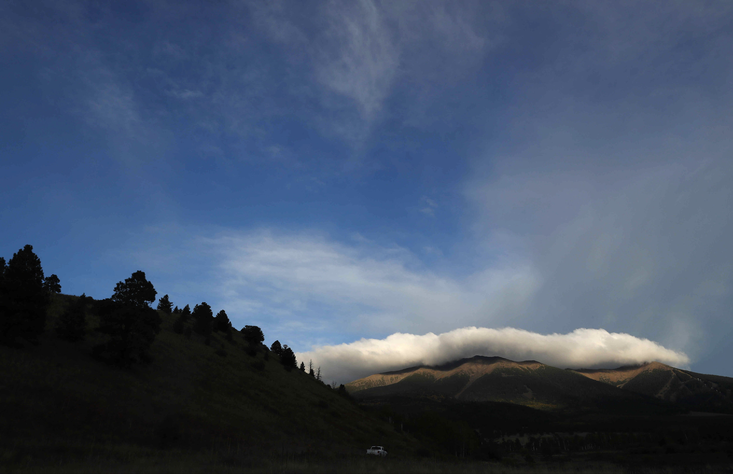 Clouds settle on the San Francisco Peaks before a storm on Tuesday, Sept. 27, 2016, in Flagstaff, Ariz. (Kevin Martin)