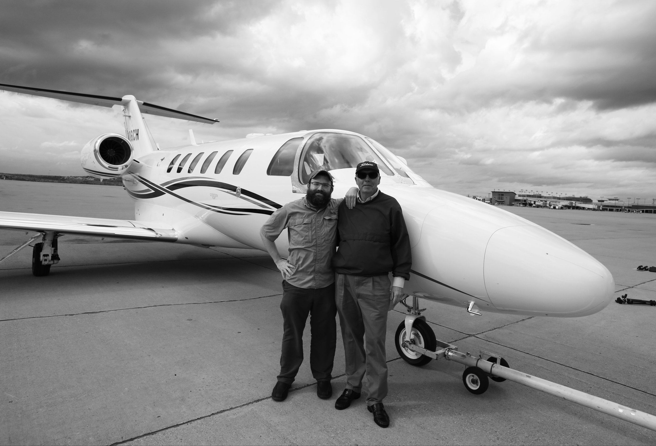 My father and I after his final flight. When he would leave for flights during my childhood, I would hold on to his pant leg until he gave me a dollar. I would give a lot more than that to fly with him again.