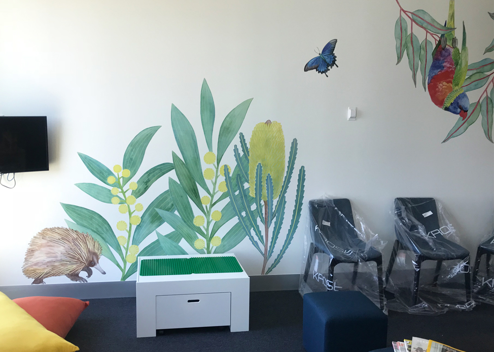 Echidna, wattle, banksia flower, blue ulysses butterfly and lorikeet in the waiting area.