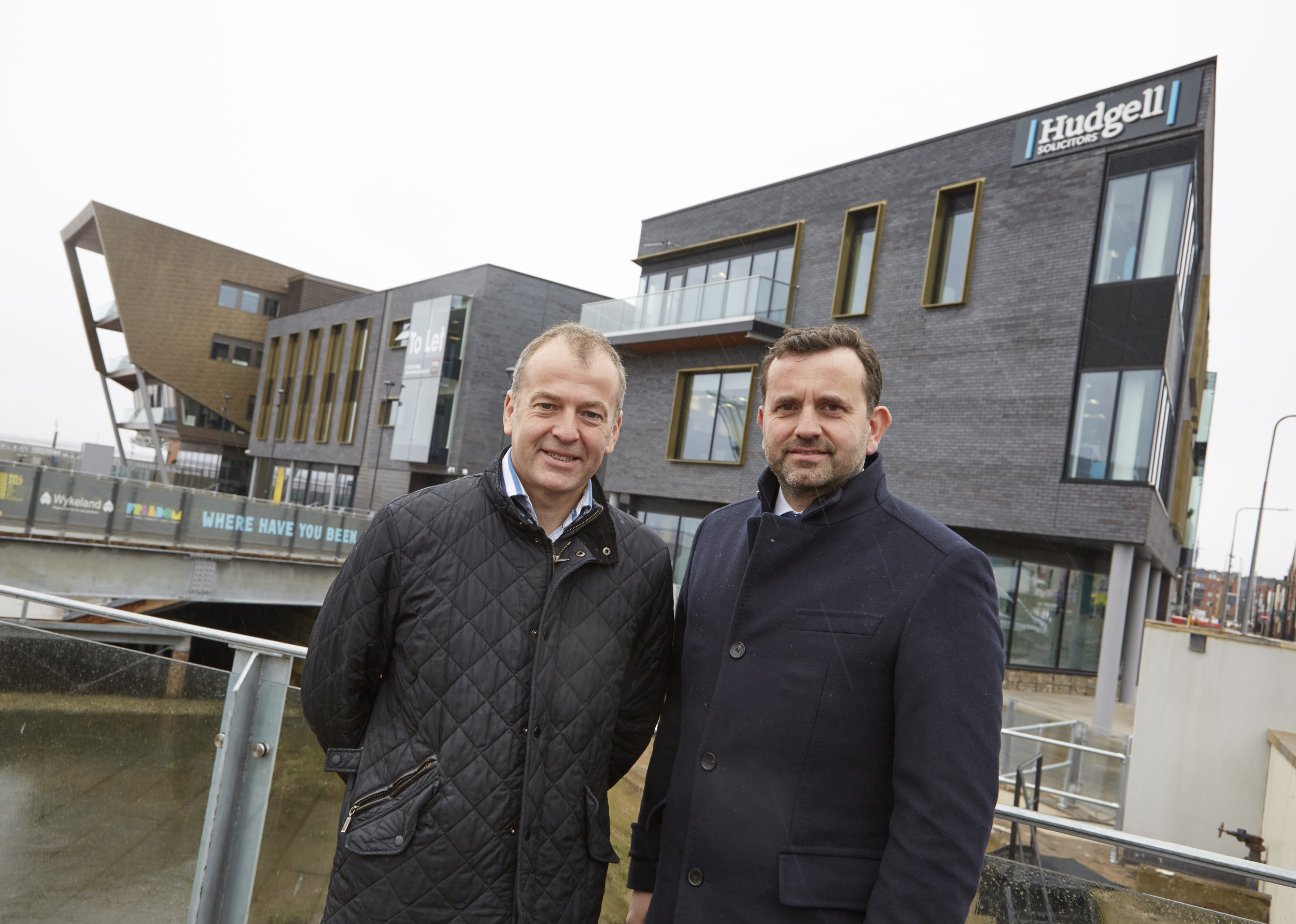 Hudgell Solicitors Managing Director Neil Hudgell, left, with Wykeland Group Managing Director Dominic Gibbons at the @TheDock development in Hull's Fruit Market. The specialist law firm says its move to the site demonstrates its long-term commitment to Hull.