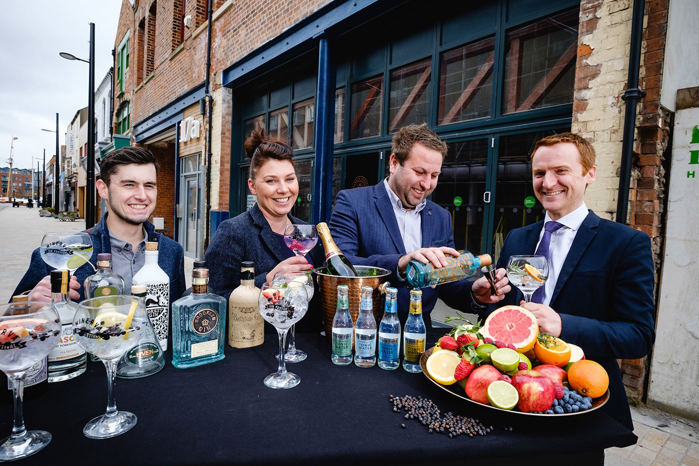 From left, Craig Heads, Charlotte Bailey and Lee Kirman from Humber Street Distillery Co with Wykeland Group's Tom Watson and some of the 100 varieties of gin that will be on offer at the new gin bar and distillery.