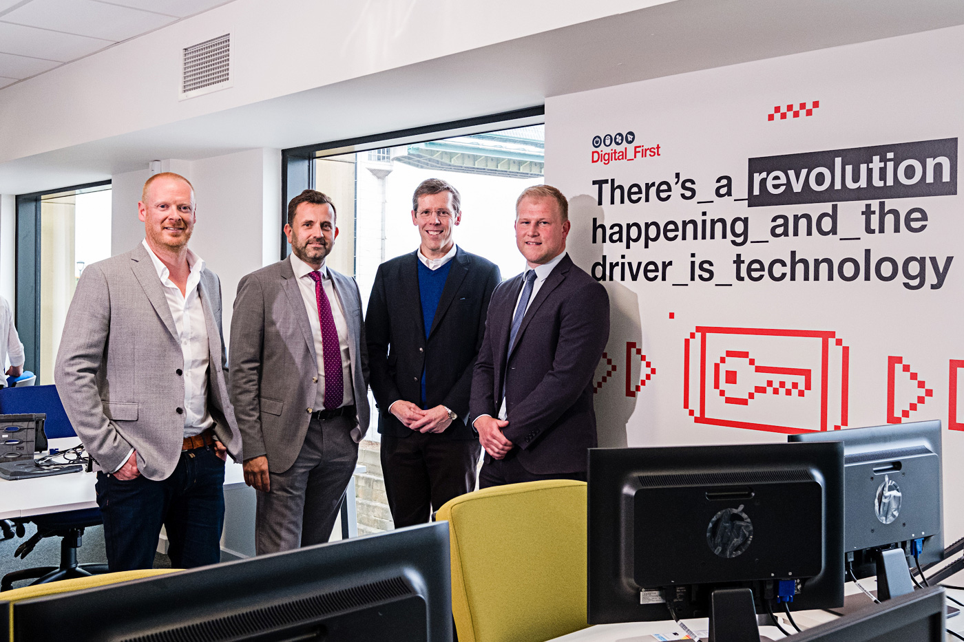 From left, Arco Digital Director Richard Martin, Wykeland Group Managing Director Dominic Gibbons, Arco Chief Executive Neil Jowsey and Wykeland Asset Manager John Gouldthorp at the new offices for Arco's digital team in Wykeland's @TheDock development.